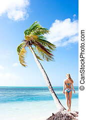 Tranquility - Tranquil scene with palm tree and blonde girl...