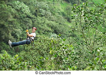 Happy Tourist On Zip Line Tour - Adult Man On Zip Line...