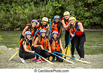 Group Of People On Whitewater River Rafting