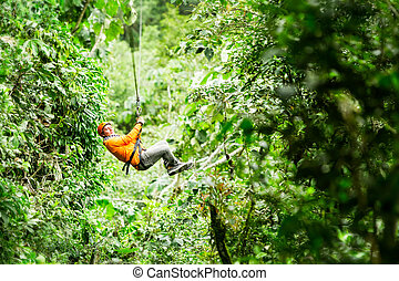 Flying Trough Ecuadorian Rainforest - Adult Tourist On Zip...