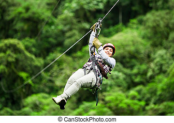Adult Woman On Zip Line Against Blurred Forest - Adult...
