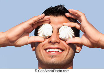 Man Covering His Eyes With Seashells - Pearl Diver Fooling...