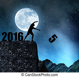 Concept New Year 2016 - Silhouette of man throws fives....