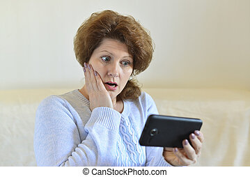 woman in amazement looking at  smartphone