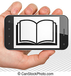 Science concept: Hand Holding Smartphone with Book on display