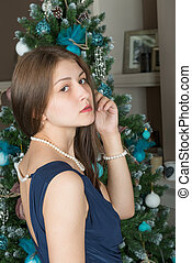 Portrait of a cute girl on a background decorated Christmas...