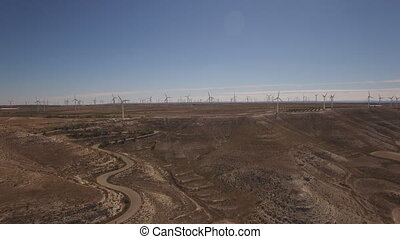 Approaching to wind turbines farm in plateau, 4k - Aerial...