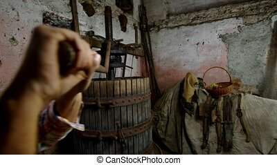 old wine press - winemaker working with old grapes press