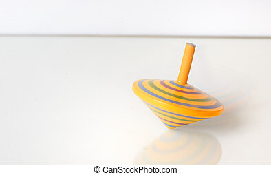 Whirligig in motion on white table