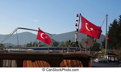 Turkish flags waving on board