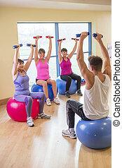 Three women using weights