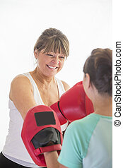 Woman training with boxing gloves
