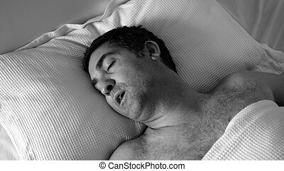 Man snoring in bed - Man in his forties 40s snoring in bed...