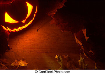 Scary halloween night with spooky evil face of jack o lantern in