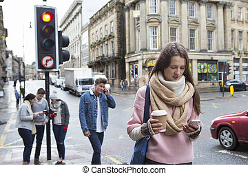 Young adults in the city - A young woman can be seen walking...