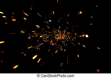 Glowing Flow of Sparks - A glowing flow sparks against a...