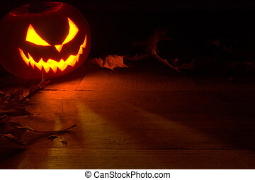 pooky halloween background face of jack o lantern in the...
