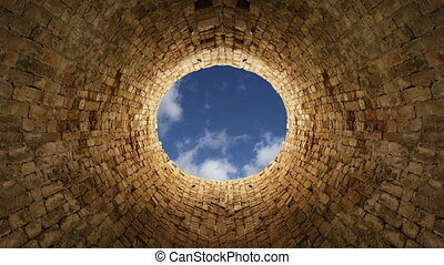 Sky with clouds from the stone well - View of the sky with...