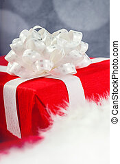 Gift or present wrapped in red paper and tied with white...
