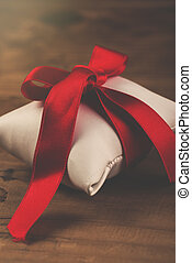 Wrapped gift - Gift or present wrapped and tied with red...