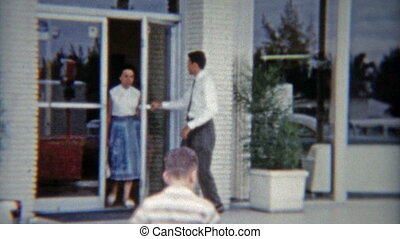 1959: Car saleman opening door for - Vintage 8mm film home...