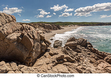 Rocks and beach on the coast of Sardinia near Rena Majore -...
