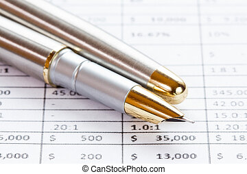 Image of financial report with pen