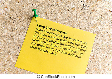 long investments word typed on a paper and pinned to a cork...