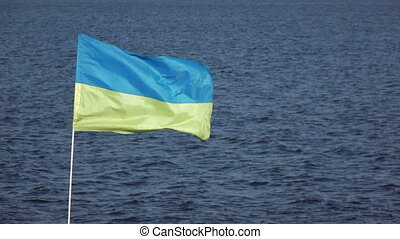 Ukrainian flag on nature - On background of blue sky...
