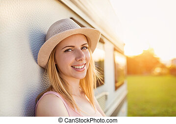Beautiful woman outside the camper van - Beautiful young...