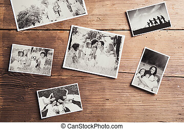 Family photos laid on a table - Black and white family...