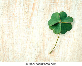 Closeup clovers leaves  setup on wooden background.