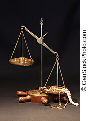 Pawn Shop - Old brass weight scale with various jewelry on...