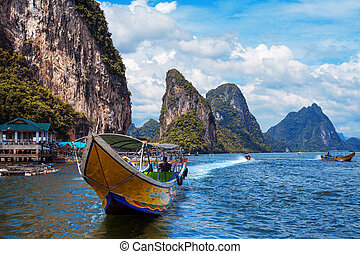 long boat and rocks on railay beach in Thailand - long boat...
