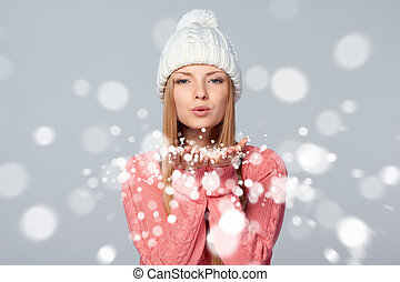 Woman blowing snow at you - Christmas Girl. Beautiful...