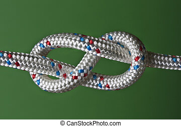 eight rope knot - rope knot isolated on the green background
