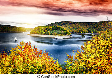 Autumn landscape with spectacular sunset over river