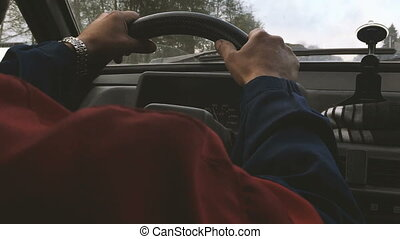 Man driving car close up back view. - Hands of man driving...