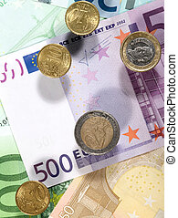 Money background from euro banknotes and coins