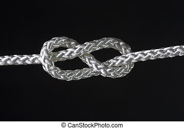 eight rope knot - rope knot isolated on the dark background