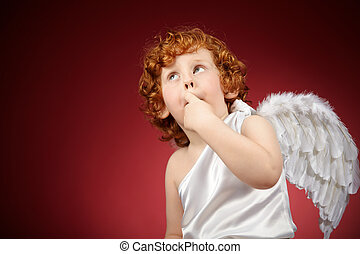 Little angel - Portrait of the little boy with wings behind...