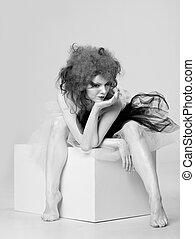 fallen angel. adult pretty woman posing in studio
