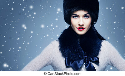 Fashion style portrait of a woman in an elegant winter fury...