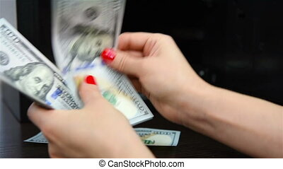 Womans hands counting money, close up