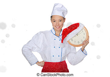 Asian chef with clock and Christmas hat in falling snow