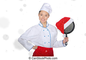 happy asian chef with frying pan and Christmas hat in...