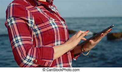 Girl with digital tablet on a ocean background