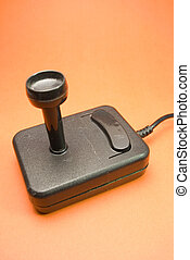 Video joystick - black video joystick from 80's on orenge...