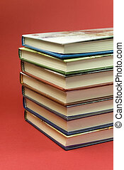 7 stack books detail - detail of 7 stack books on red...