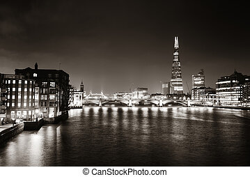 London - Southwark Bridge and London skyline at night.